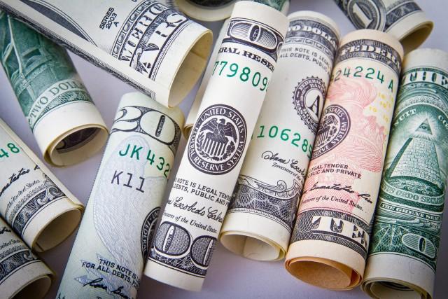multiple rolled dollar bills