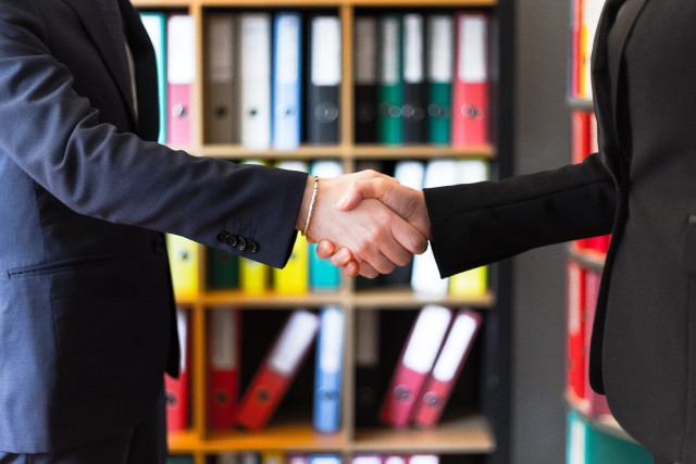 Handshake After Agreeing to Buy or Sell a House